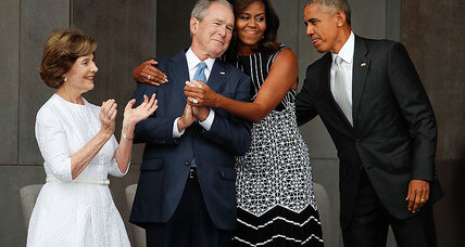 George W. Bush, Michelle Obama share a hug at black museum opening