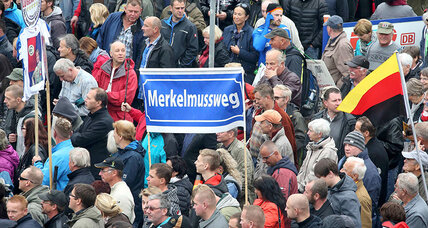 Angela Merkel faces protests on anniversary of German reunification