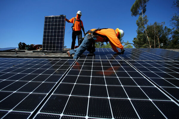 Solar installers from Baker Electric place solar panels on the roof of a residential home in Scripps Ranch, San Diego, Calif. Mike Blake/Reuters/File