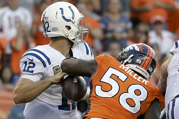 denver vs kansas city. denver broncos outside linebacker von miller, right, forces a fumble by indianapolis colts quarterback andrew luck during nfl football game in on vs kansas city