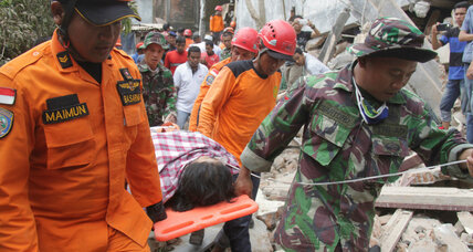 Rescue workers search for survivors in 6.5-magnitude earthquake in Indonesia