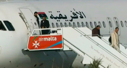 Libyan plane hijacking: Dozens of passengers freed at Malta airport