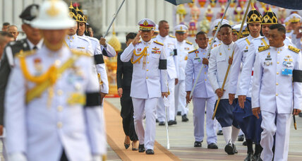 In step toward stability, Thai king signs new constitution