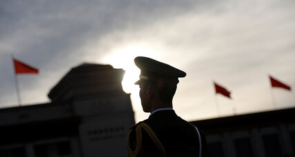 Why is the Chinese government encouraging its citizens to report foreign spies?