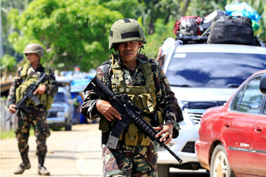 ISIS-linked militants lay siege to city in southern Philippines, Duterte declares martial law