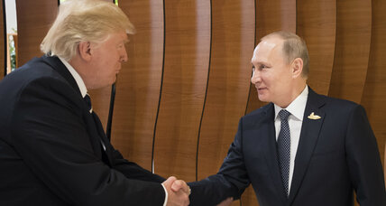 Grins and handshakes as Trump meets Putin at leaders' retreat