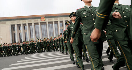 As global reach grows, China builds military to match