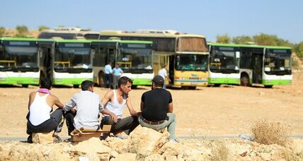Syrian rebels, refugees leave enclave in Lebanon