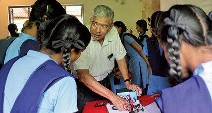 The man and fellow retirees behind a science lab for students in rural India