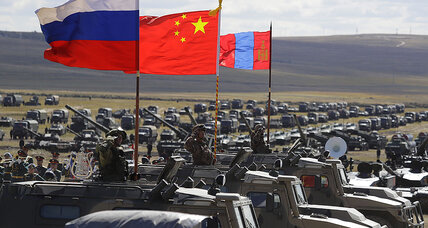 Putin's war games send signal to West, but Russia-China alliance unlikely