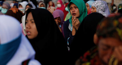 In Indonesia, some survivors refuse to give up hope