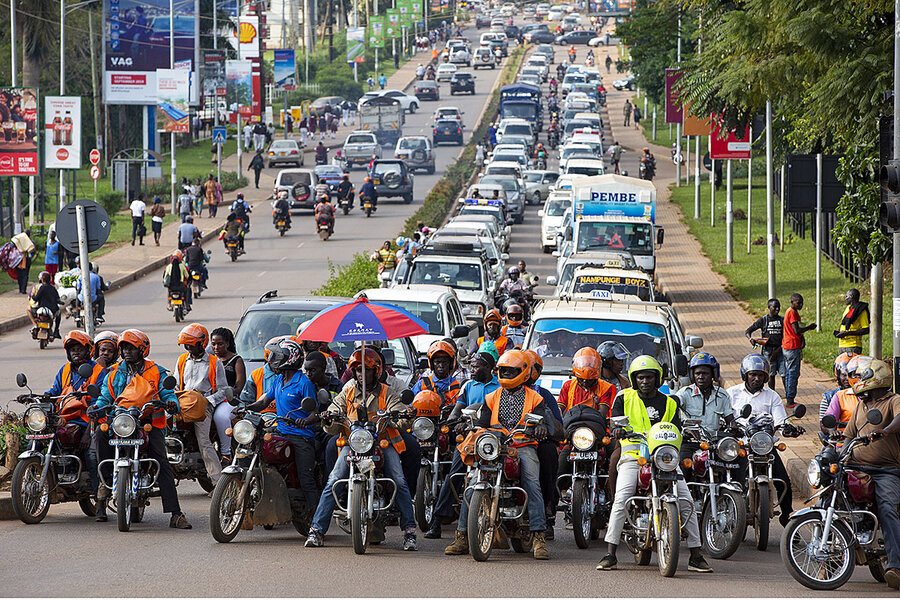 Uganda motorcyle taxis skirt traffic, but also make it worse ...