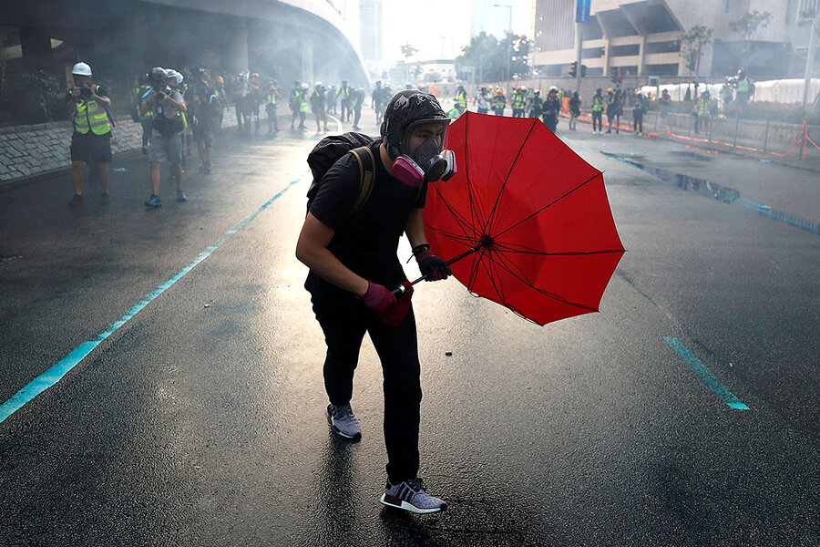 As China's National Day approaches, Hong Kong protests cast a shadow