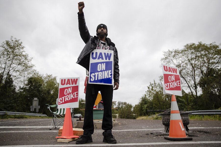 UAW reaches tentative deal with GM, workers cautiously hopeful