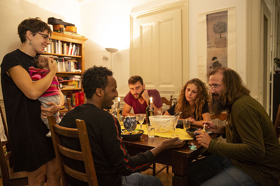 At these Swiss dinner tables, refugees hold the seat of honor