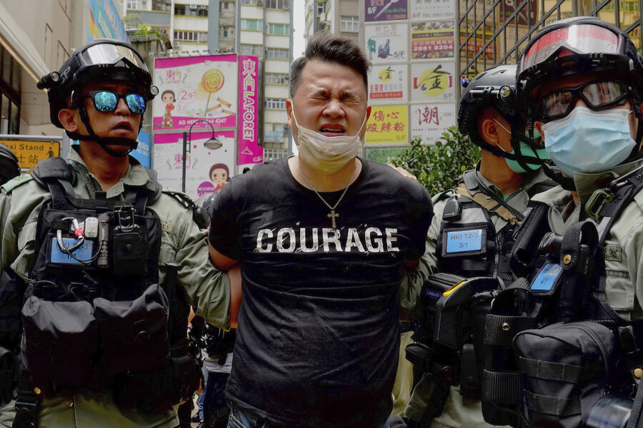 In Hong Kong, arrests begin a day after...