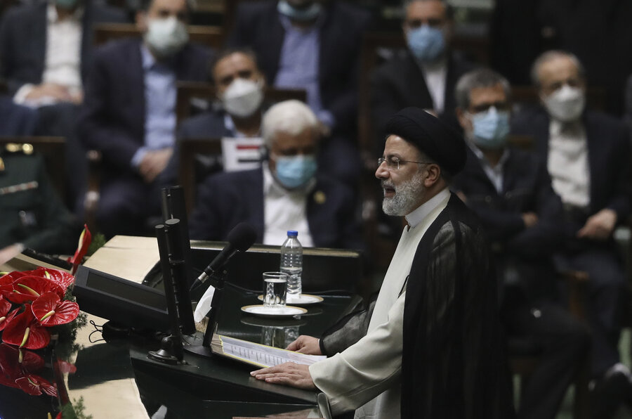 Continuing hostility to West, Iran swears in hard-line president
