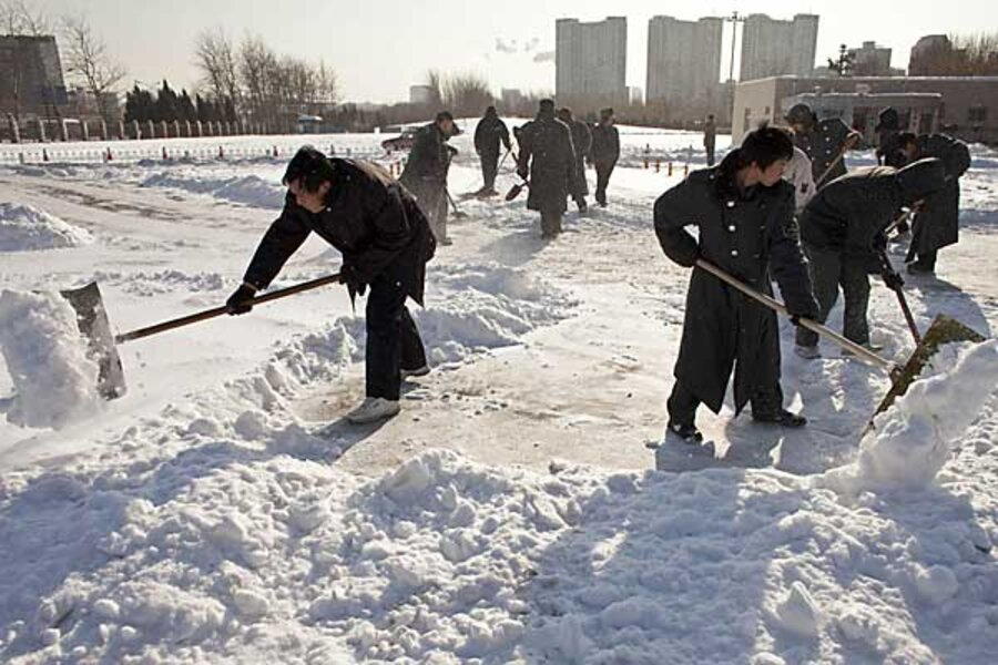 Beijing Battles Heaviest Snowfall In Decades With Shovels