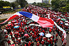 Thai PM confronted with red-shirt protesters' bloody stunt