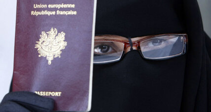 In land of few burqas, France debates a ban