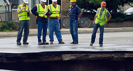 Milwaukee sinkhole that gobbled car, stoplight: Will it grow?