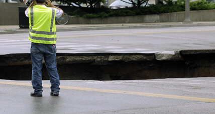 Milwaukee sinkhole swallows SUV and traffic light