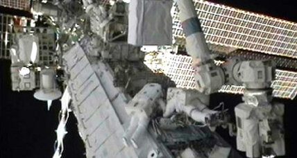 Space station astronauts venture outside, continue repairs