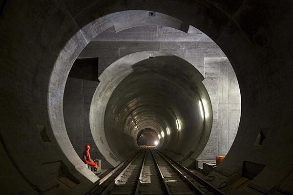 swiss tunnel workers drill through last few feet of rock
