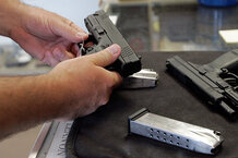 csmarchives/2011/01/0111-united-states-guns.jpg