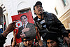 Tunisia's opposition defends unity government as pressure mounts