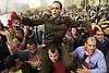 Cairo protesters: 'We're staying here until Mubarak leaves.'