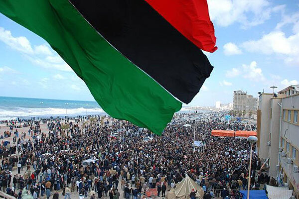 Libya protests spread as barrier of fear crumbles csmonitor libya protesters wave a flag in this undated picture made available on facebook sunday the image was purportedly taken recently in benghazi sciox Choice Image