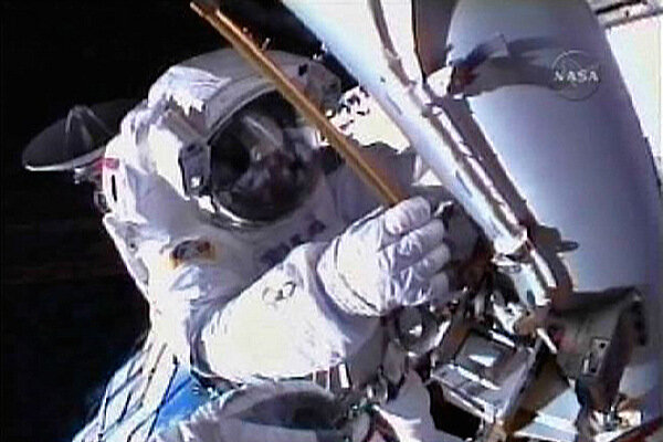 Discovery astronauts prepare to bottle outer space during ...