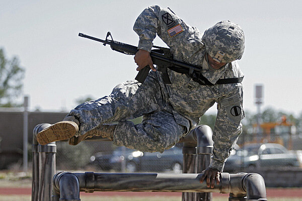 U S Army Sgt Cornelius Trammell Clears A Hurdle As He Demonstrates One Of The Elements New Combat Readiness Test At Fort Jackson