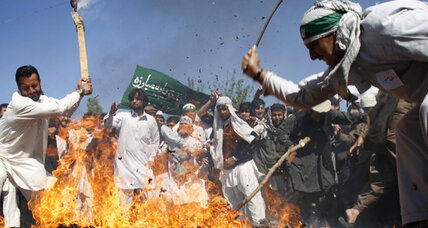 Afghan mullahs push peaceful protest in wake of Quran-burning violence