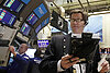 Stocks end sharply lower on global concerns