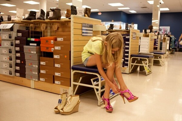 Harriet Rovniak, 10, tries on sky-high heels for fun in a department store  in Natick, Mass., in August. An IBM survey of social media say heel heights  are ... - High Heels: The New Economic Indicator? - CSMonitor.com