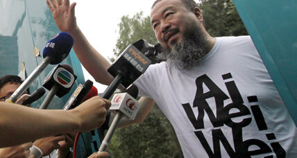 In defiant gesture, Chinese surge forward to help Ai Weiwei pay tax bill