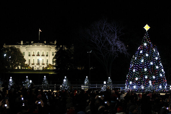 The National Christmas Tree is lit in front of the White House during its  lighting ceremony in Washington December 1, 2011.