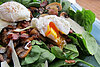 Warm spinach salad with bacon, mushrooms, and a poached egg